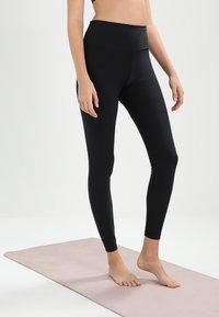 Nike Performance - SCULPT HYPER - Leggings - black/clear - 0