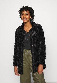Vero Moda - VMCURL HIGH NECK JACKET - Winter coat - black - 0