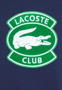 Lacoste - Sweatshirt - scille - 7