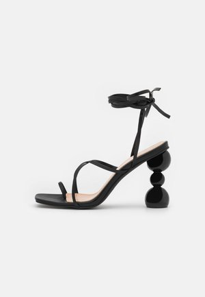 CLAUDIA - T-bar sandals - black