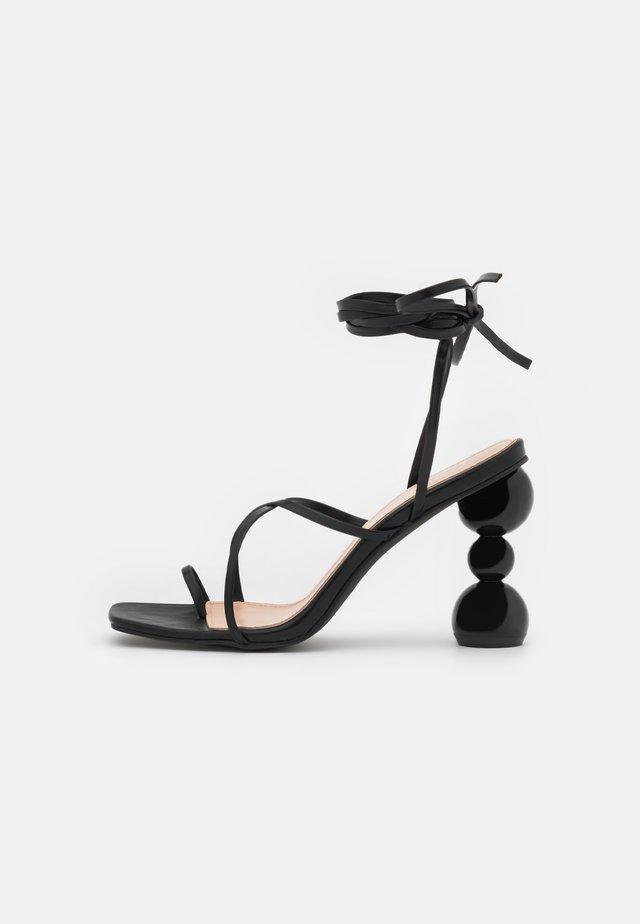 CLAUDIA - Flip Flops - black