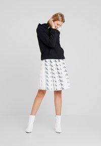 Calvin Klein Jeans - PLEATED SKIRT - A-line skirt - white/black - 1