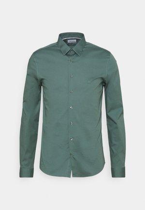 LOGO STRETCH EXTRA SLIM - Formal shirt - balsam green
