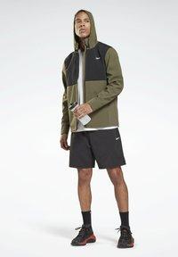 Reebok - LES MILLS ATHLETE - Pantalón corto de deporte - black - 1