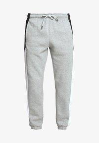 Nike Sportswear - Tracksuit bottoms - dark grey heather/white/black - 4