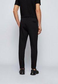 BOSS ATHLEISURE - Pantalon de survêtement - black - 2