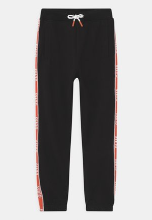 JUNIOR ACTIVE - Tracksuit bottoms - jet black