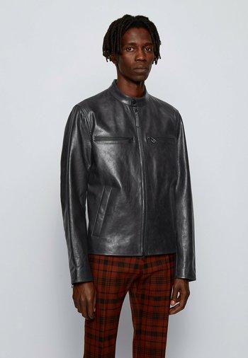 NADILO - Leather jacket - black