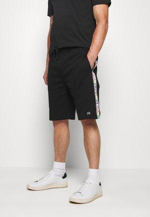 PRIDE  - Pantalones deportivos - black