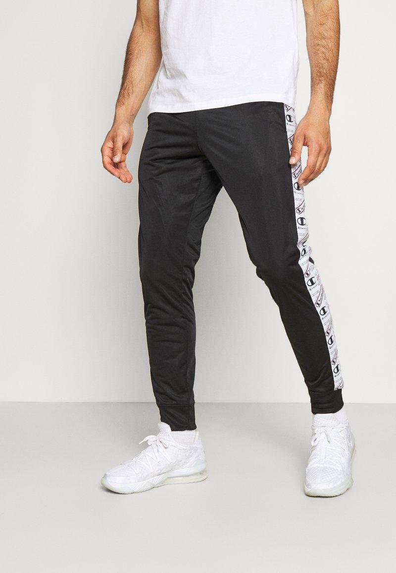 Champion - CUFF PANTS - Tracksuit bottoms - black