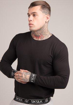 LOUNGE TEE - Pyjama top - black