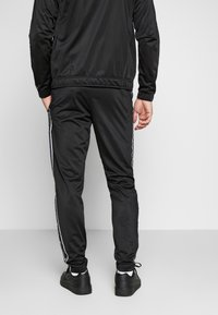 Champion - TRACKSUIT TAPE - Survêtement - black - 4