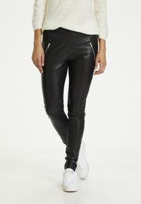 Kaffe - Leather trousers - black deep / gold - 0