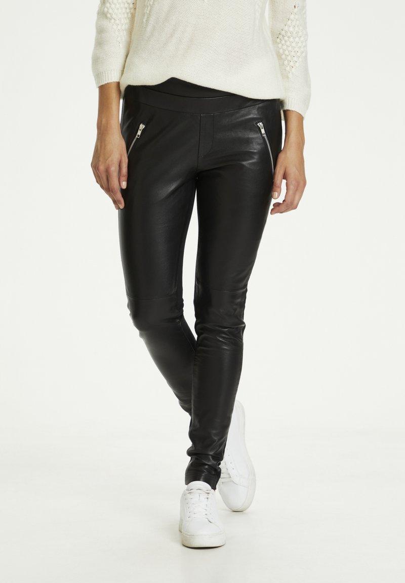 Kaffe - Leather trousers - black deep / gold