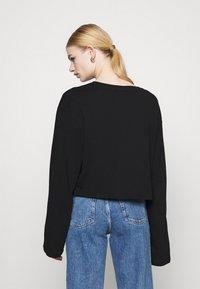 Weekday - SMASH LONG SLEEVE - Langærmede T-shirts - black - 2