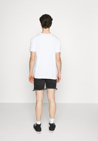 The Couture Club - BANDANA PATCH AND PAINT SPLAT CUT OFFS - Denim shorts - washed black - 2