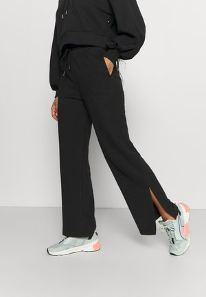 HER WIDE PANTS - Tracksuit bottoms - puma black