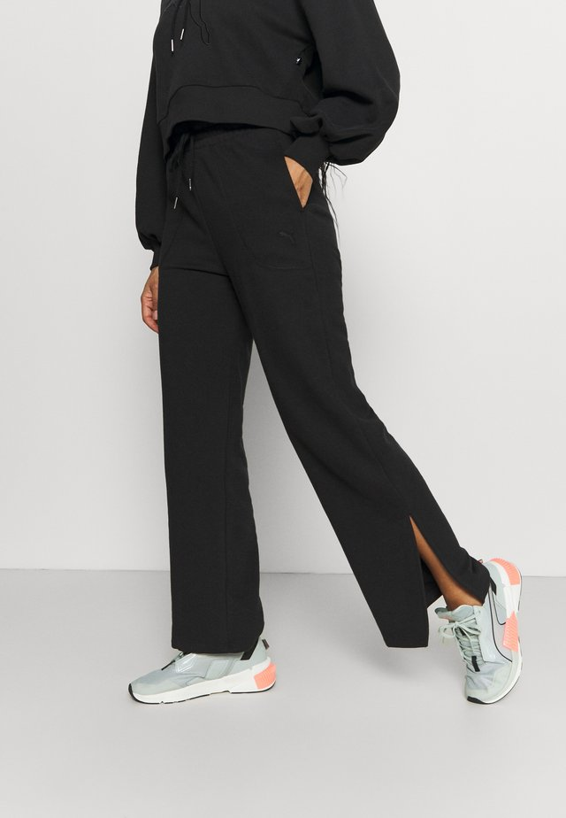 HER WIDE PANTS - Tracksuit bottoms - puma black