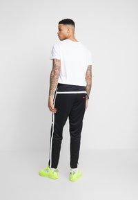 Nike Sportswear - M NSW NIKE AIR PANT PK - Verryttelyhousut - black/white - 2