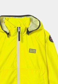 LEGO Wear - JORI 201 JACKET UNISEX - Waterproof jacket - neon yellow - 3