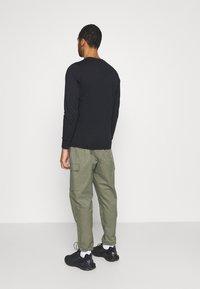 Nike Sportswear - Tracksuit bottoms - twilight marsh/white - 2
