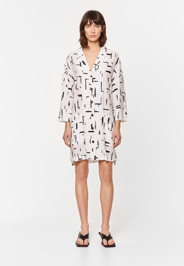 Blousejurk - paper lines white