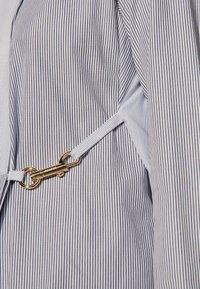 sandro - MADDLY - Button-down blouse - marine/ecru - 4