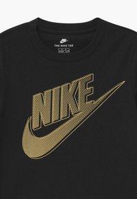 Nike Sportswear - CLUB FUTURA GRAPHIC TEE - Print T-shirt - black - 2