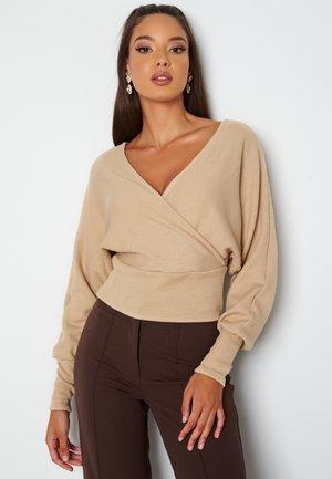 REGINA - Stickad tröja - tan