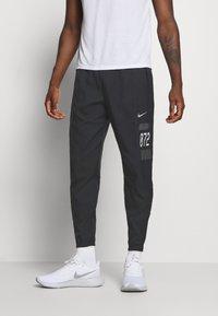 Nike Performance - PANT - Tracksuit bottoms - black/silver - 0