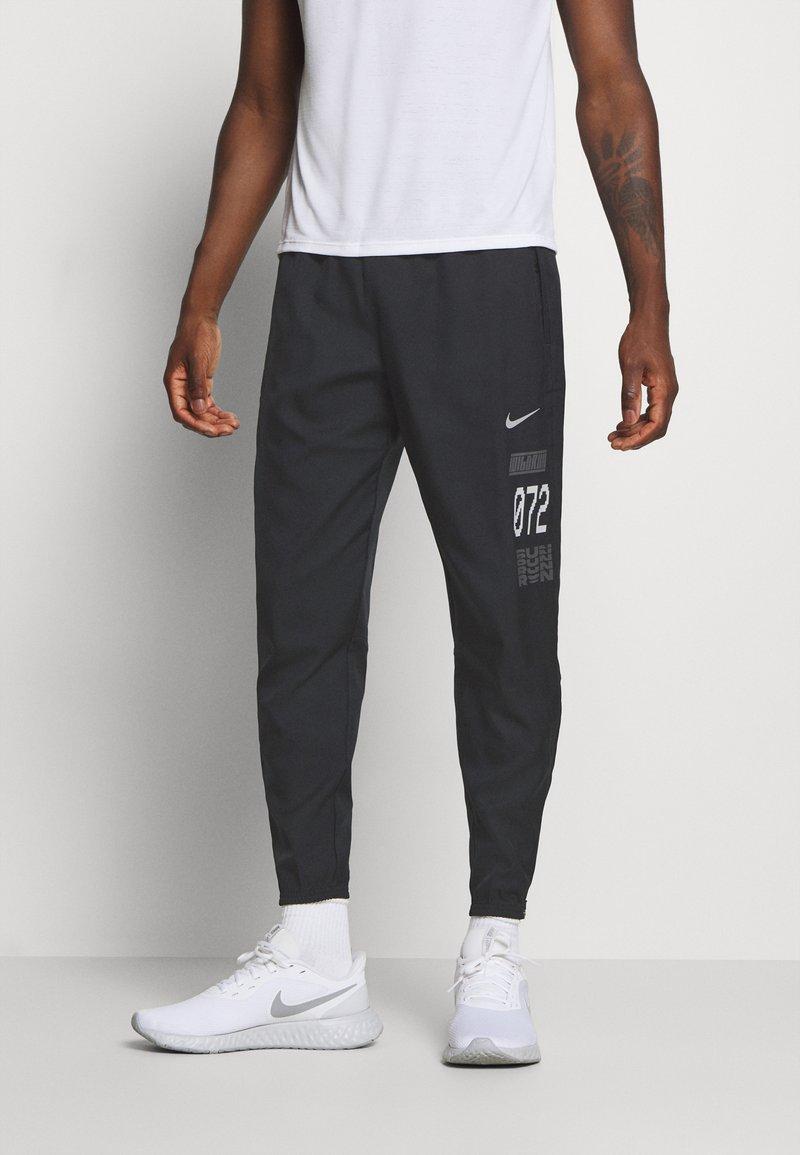 Nike Performance - PANT - Tracksuit bottoms - black/silver