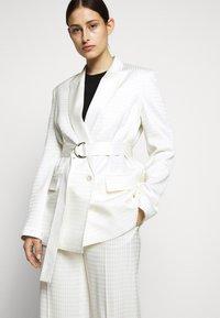 KARL LAGERFELD - CAMEO BELT - Short coat - off white - 3