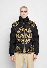 Karl Kani - RETRO REVERSIBLE PUFFER JACKET UNISEX  - Light jacket - black - 0