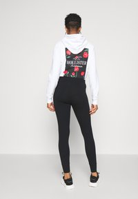 Hollister Co. - LOGO FLEGGINGS - Leggings - Trousers - black - 2