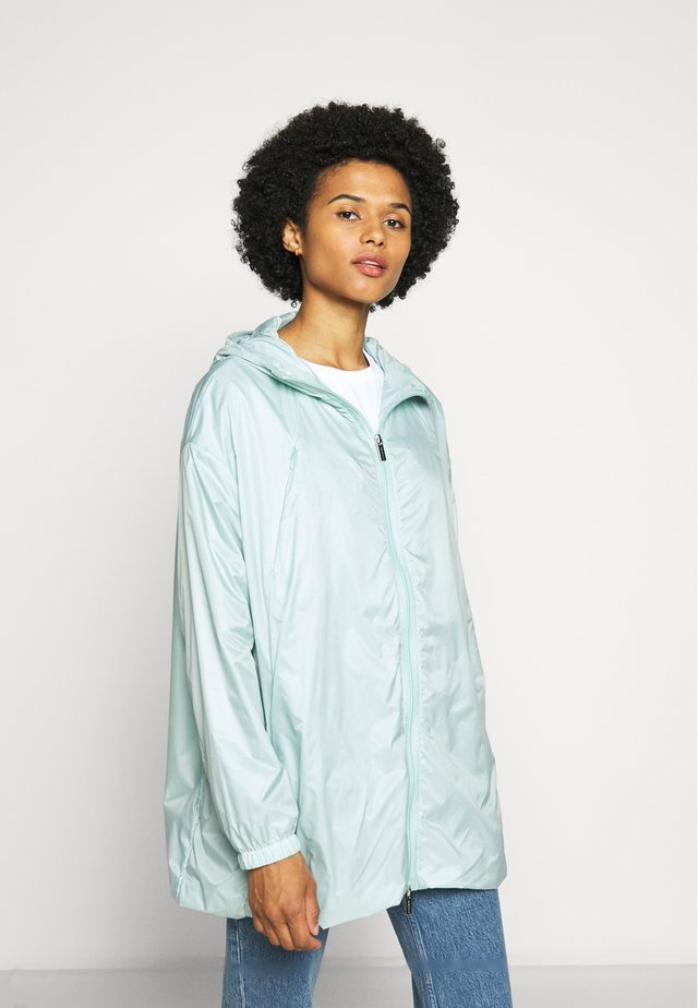 WATER REPELLENT AND WINDPROOF - Waterproof jacket - blue haze