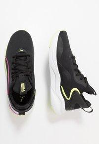 Puma - SOFTRIDE RIFT TECH - Zapatillas de running neutras - black/fizzy yellow - 1