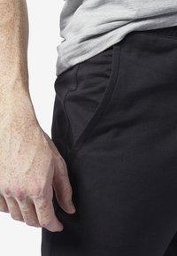 Reebok - TRAINING ESSENTIALS LOGO JOGGER PANTS - Tracksuit bottoms - black - 4