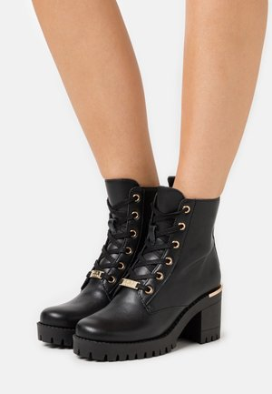 BECOME - Platform ankle boots - black