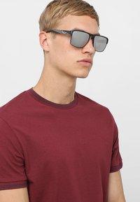 Emporio Armani - Sunglasses - matte black - 1