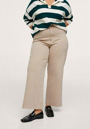 CATHERIN - Flared Jeans - zand