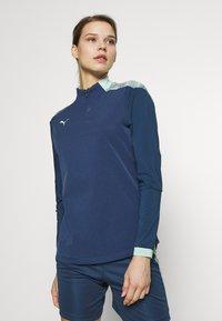 Puma - FTBLNXT 1/4 ZIP - Sports shirt - dark denim/mist green - 0