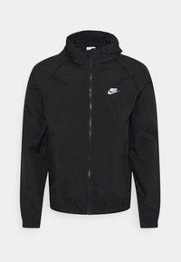 Nike Sportswear - TRACK - Kevyt takki - black/white - 0