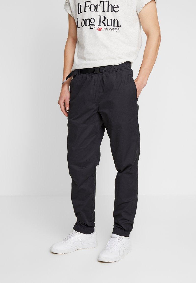 New Balance - ATHLETICS PANT - Trousers - black