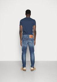 Diesel - D-FINING - Jeans Tapered Fit - blue denim - 2