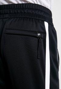 Nike Sportswear - AIR PANT - Träningsbyxor - black/white - 4