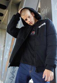 MOSCHINO - Winter jacket - black - 2