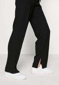 HUGO - HILIKA - Trousers - black - 3