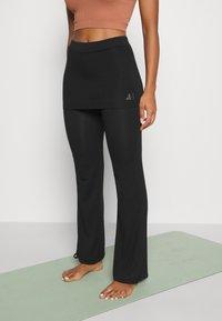 Curare Yogawear - PANTS SKIRT - Teplákové kalhoty - black - 0