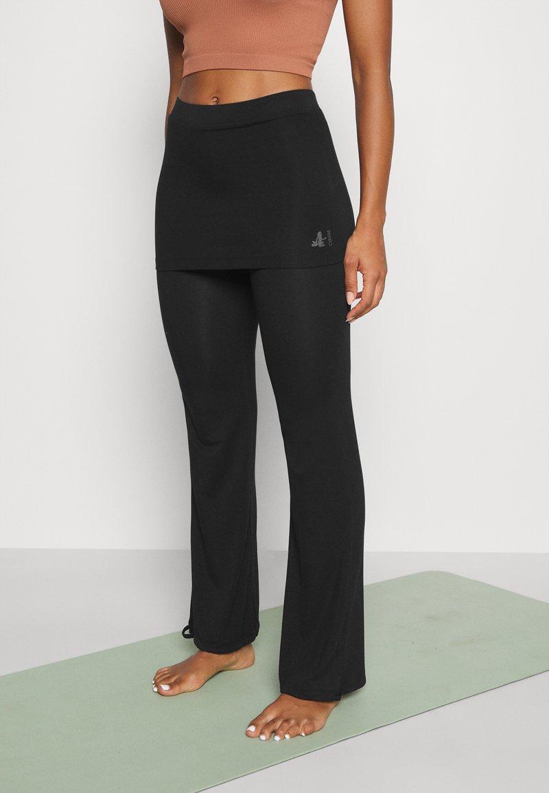 Curare Yogawear - PANTS SKIRT - Teplákové kalhoty - black