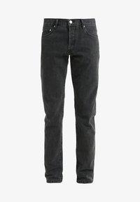 Zúžené džíny - black stone wash